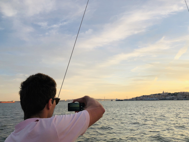 Guests taking pictures at Lisbon sunset